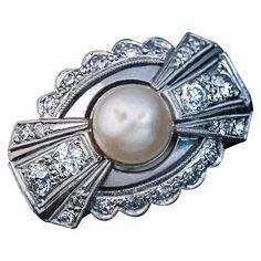 Art Deco Bow Motif Pearl Diamond Ring | From a unique collection of vintage cocktail rings at https://www.1stdibs.com/jewelry/rings/cocktail-rings/