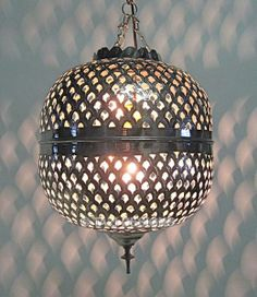 moroccan lamp casts cool light on the walls.  Bedroom hall