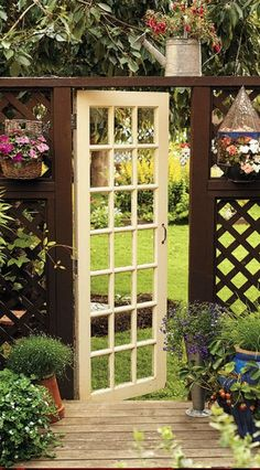 #Fencing: repurposing old door, sans windows, as garden gate.  (use the shorter window and add chicken wire)                                                                                                                                                     More