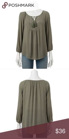 Peasant top Product Details Wear this peasant top with your favorite jeans for a fashionable, easy look.  PRODUCT FEATURES Tasseled tie scoopneck 3/4-length sleeves Elastic cuffs FABRIC & CARE Rayon Machine wash Tops
