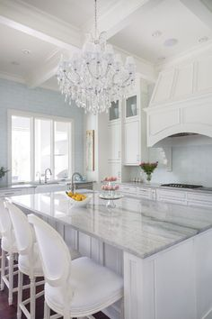 Marble Kitchen with a gorgeous chandelier!!