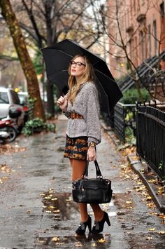 black heels + rust tights + animal print dress + gray sweater + brown belt + nerd glasses
