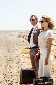Love the white trousers and short wavy hair #007