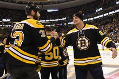 Those are some big boys... Zdeno Chara (Bruins) and Rob Gronkowski (Patriots) lock up after Gronk spikes the ceremonial puck!
