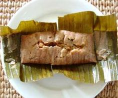 Pasteles! Definitely a Thanksgiving/Christmas staple. It's pretty much a stuffed plantain tamale of sorts, boiled in a banana leaf.