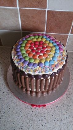 Rainbow cake, smarties, buttons, chocolate fingers and minstrels.