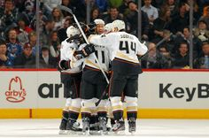 A hockey bear hug overtaking new Duck Dan Winnik.