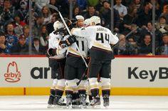A hockey bear hug overtaking new Duck Dan Winnik.