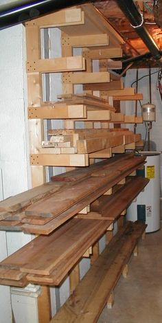 """Lumber storage: """"My rack is 2x4s floor-to-ceiling and 1/2"""" plywood for the arms that hold the the wood. I was a little skeptical of the strength of this design, but I got a free rack when I bought a trailer-load of lumber a few years back that was constructed this way. I changed it around a bit to match my available space...and ended up with what you see on my site, here:..."""""""