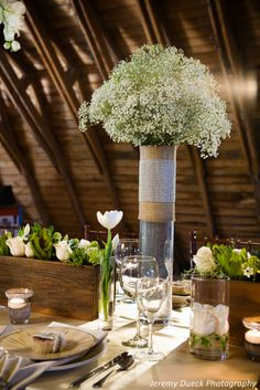 Babies breath centerpiece     Jeremy Dueck Photography    green and white table scape white roses  rustic table scape