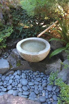 A 'tsukubai' (stone basin) at the Portland Japanese Garden. photo by Jan Johnsen.