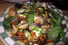 The Taiwanese Clams at Mission Chinese Food are made with hot basil, garlic, chinese bacon and black bean sauce.    Mission Chinese Food opened within Lung Shan Restaurant, at 2234 Mission Street, in 2011. Its origins trace to a sublet Guatemalan taco  Create delicious meals exactly like this and lose the weight! check out  http://bestonlineproducts.net/food