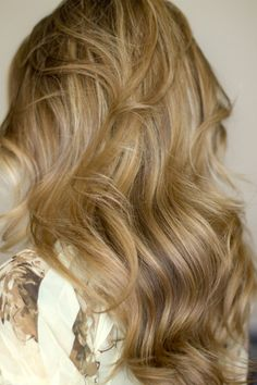 Voluminous waves with a curling iron.