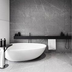 Here we have a dream bathroom - featuring black, white and marble! By #tamizoarchitects - first seen on the gorgeous feed of @crystaljohnsonid - #marble #bathroom #blackandwhite #architectualdesign #freestandingbath
