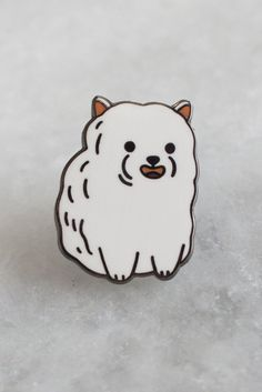 Just looking at this puffy fluffy lil dude is probably a good way to improve your day. 18mm tall lapel pin in rose gold metal with hard enamel fill. Designed by Julia Bereciartu.