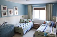 Shared boys room. Pottery Barn quilts light blue walls with wainscoting. Tall curtain rod.