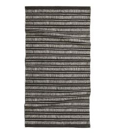 Check this out! Rectangular rug in woven cotton fabric with a printed pattern at front. - Visit hm.com to see more.