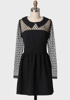 Natalia Dress By Darling UK 84.99 at shopruche.com. Fall in love with this delightful black collared dress with charming polka-dotted mesh sleeves and paneling for an alluring look. Finished with a flouncy, fully lined skirt and an exposed back zipper. This exquisite dress is ideal for a dinner date or an...