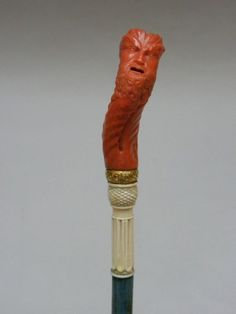 Cane, made of Trapani coral and ivory. Blue tinted shaft. Italian, dating to 1760