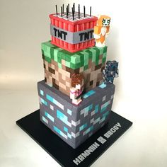 """Minecraft Cake three tier Minecraft cake featuring Stampy (cat), Pat & Jenn characters. All squares cut with 1/2"""" square cutter (..."""
