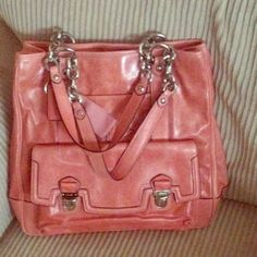 """Coach Pink Leather Poppy Tote This bag is in great condition. Only used a couple of times. No flaws. Leather, geranium pink, silver hardware, inside zip, cell phone and multifunction pockets, center zip compartment, snap closure, fabric lining. Handles with 7"""" drop. Outside push lock pocket. Coach Bags Totes"""