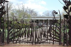 Enjoy the view of the Kohl Gate at the Cleveland Botanical Garden . It was created  by Albert Paley  in May, 2004.  The metallic-brown struc...