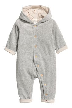 Gray. BABY EXCLUSIVE/CONSCIOUS. Jumpsuit in organic cotton velour. Jersey-lined hood, long raglan sleeves, and buttons at front continuing along one leg.