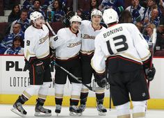 You have to wait until all the players can join in the hockey hug!