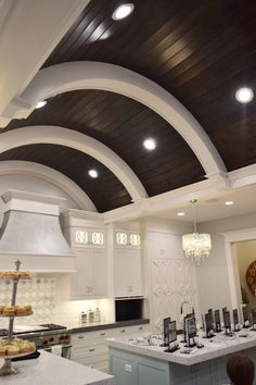 Wood barrel ceiling with recessed lighting