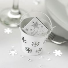 These oh so cute white snowflake buckets are just perfect for Christmas table favours or if you are planning a winter wonderland wedding. Just add matching snowflake milk chocolates, or silver and white sugared almonds for your guests to enjoy.  Pack of 5 for £7.99 empty from the Online Fuschia Boutique at www.fuschiadesigns.co.uk