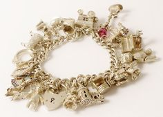 Vintage Steling Silver Charm Bracelet / 18 Sterling Charms / Heart Padlock / Openers / Movers on Etsy, $160.00