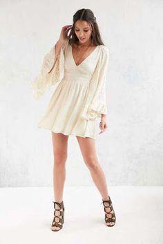 Derin V yakalı yazlık mini elbise