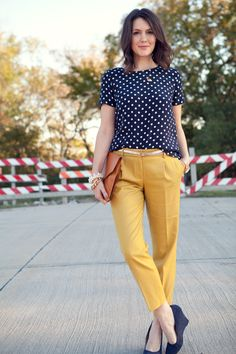Cute polka dot top // The perfect preppy look for fall. Take a break from your neutral trousers and get adventurous with a pop mustard yellow pair.
