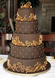 Chocolate & Gold Wedding Cake - My entry in a Chocolate Wedding Cake Contest. Chocolate fondant with chocolate gumpaste scrollwork. I painted the scrollwork with luster dust. Gorgeous Cakes, Pretty Cakes, Amazing Cakes, Chocolate Gold, Chocolate Fondant, Chocolate Lovers, Chocolate Wedding Cakes, Chocolate Ganche, Unique Cakes