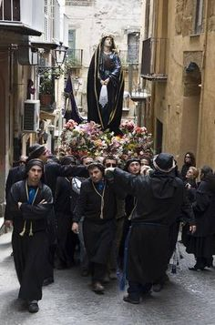 Men Carry the Madonna through the streets of Agrigento, Sicily #agrigento