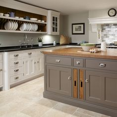 Two neutral colours on traditional kitchen cabinets by Humphrey Munson Nickleby - Felsted Showroom 5