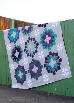 Big blocks make this project a quick quilt with a modern flare! This fun quilt pattern is Fat Quarter Friendly, includes 4 sizes, and has a bonus Wallhanging pattern!
