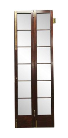 Tall slim frame bi-fold dark stained wooden French doors with 12 lites. The solid brass hardware is intact. Priced per pair of connected […]