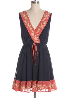 Lovely navy and bright coral dress with embroidered details. Elastic waist. Fits large. 100% polyester Not stretchy Lined Hand wash cold; hang dry Shop Cute Dresses and Clothing - Canada Cancun Weather Dress in Navy -