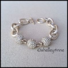 Silver Pavé Charm Bracelet NWOT By Elizabeth Stone, formerly Oia Jules | Lovely textured silver tone links featuring three sparkling pavé spheres | Toggle closure | NWOT | Perfect condition | Elizabeth Stone/Oia Jules Jewelry Bracelets