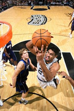 Spurs re-sign Tim Duncan! Get all the info on spurs.com.
