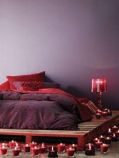 Benjamin Moore -Rosewood- on wall <3 Four pallets pressure clean and detailed paint edges, set your mattress on top. Match lamp, bedding and candles. For the amount of candles used, get odorless, and maybe a couple with scent. Boho romantic room