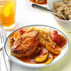 Pork Chops with Tomato Curry Recipe -This hearty flavorful dish is great on cold winter nights. I love the sweetness of the apples, the heat of the curry and the bit of almond crunch.—Mary Leverette, Columbia, South Carolina