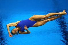 Tania Cagnotto of Italy competes in the women's 3-meter springboard diving preliminary round on Day 7 of the London 2012 Olympic Games. Description from framework.latimes.com. I searched for this on bing.com/images