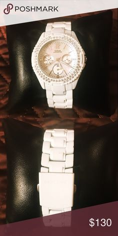 Gently used Guess white watch with rhinestones Gently used White Guess watch. Beautiful mother of pearl face, adorned by rhinestones all over face. Comes with three extra links and with small pillow as shown in picture. Used once. Needs new battery. Please check out my other items. Thank you Guess Accessories Watches