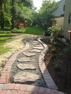Have trouble sometimes getting around your A stepping stone is the perfect landscaping option to allow people to stay dry and hassle free when outside the home. Like this pin and feel free to comment if this would look great at your place! Wet Basement Solutions, Yard Drainage, Drainage Solutions, Stone Landscaping, Garden Stepping Stones, Stone Walkway, Random House, Pathways, Outdoor Ideas