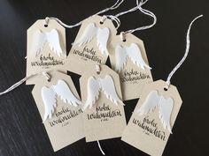 Weihnachtsgeschenanhänger in liebervoller Handarbeit gestaltet und beschriftet