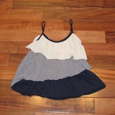 Adorable layered tank top Brand is Forever (not Forever 21). Cream, navy and cream stripes and navy layers. Such a great and fun top. 70% rayon, 25% polyester and 5% spandex. In great condition with only minimal piling throughout. Please let me know if I can answer any questions😊 Tops Tank Tops