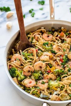 A quick and easy garlic shrimp pasta recipe with vegetables and white wine. Frozen veggies make this dish fast and budget friendly.