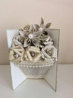 DIY Book Art Folded - Folded book art vase shape with paper flowers. Folded Book Art, Paper Book, Paper Art, Paper Crafts, Cut Paper, Old Book Crafts, Book Page Crafts, Origami, Book Folding Patterns Free